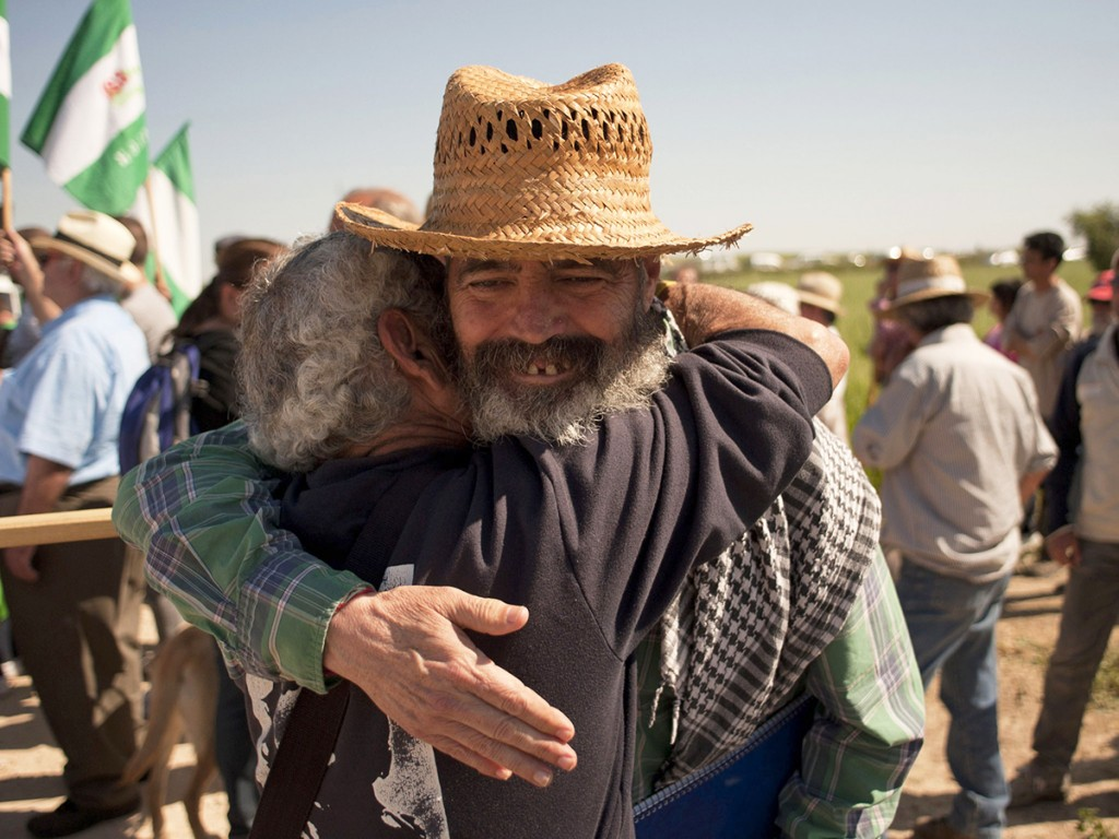 Mayor of Marinaleda and member of the regional Andalusian parliament representing the United Left (IU) party Manuel Sanchez Gordillo (R) embraces an activist of the Andalusian Union of Workers Union (SAT) as they take part to a protest during the occupation of ''Las Turquillas'', a 1,200-hectare plot of land owned by Spain's military, near the southern Spanish town of Osuna, on May 4, 2013. Some of the 500 unionists of the SAT (Andalusian Union of Workers Union) started on May 1 to occupy Las Turquillas, as they did 18 days last year, demanding to the Ministry of Defence to allow them to set up a communal agricultural project on the part of the land that is not used by militaries, more that 1,000 hectares. AFP PHOTO/ JORGE GUERREROJorge Guerrero/AFP/Getty Images